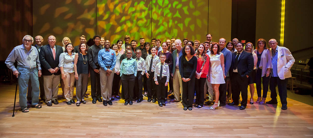 A group photo of mentor, mentees, and donors at a Music Reach event